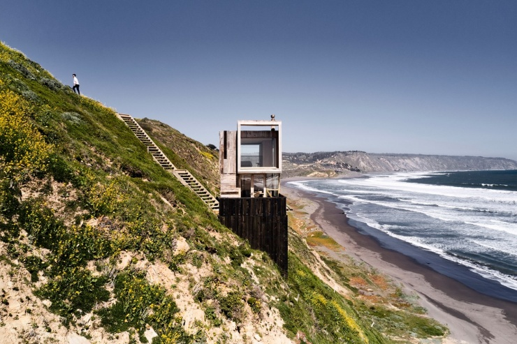 Деревянные домики для отдыха у океана в Чили (18 фото)